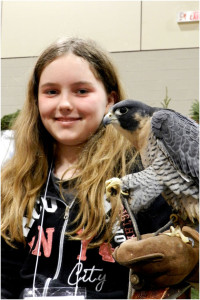 My name is Brenna. I am twelve years old. This is me at the Sportsman's Show ( as a volunteer for the Peregrine Foundation)  with a favorite Peregrine Falcon.  He was rescued, and now helps my family to educate others about raptors and wildlife, and the dangers of industrial wind turbines and their effects on wildlife.